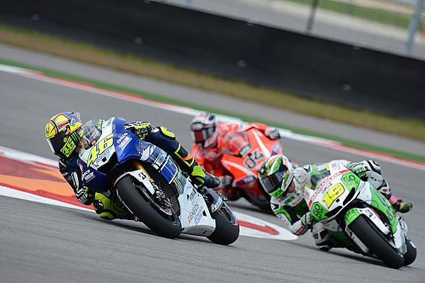 Yamaha's Valentino Rossi (46), Go&Fun Honda Gresini's Alvaro Bautista (19) and Ducati Team's Andrea Dovizioso (04).