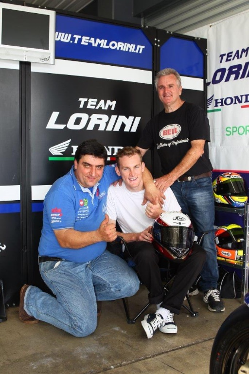 Italian team owner Livio Lorini with new recruit Melbourne's Alex Phillis, and his dad Robbie Phillis who won a world superbike race at Phillip Island in 1990