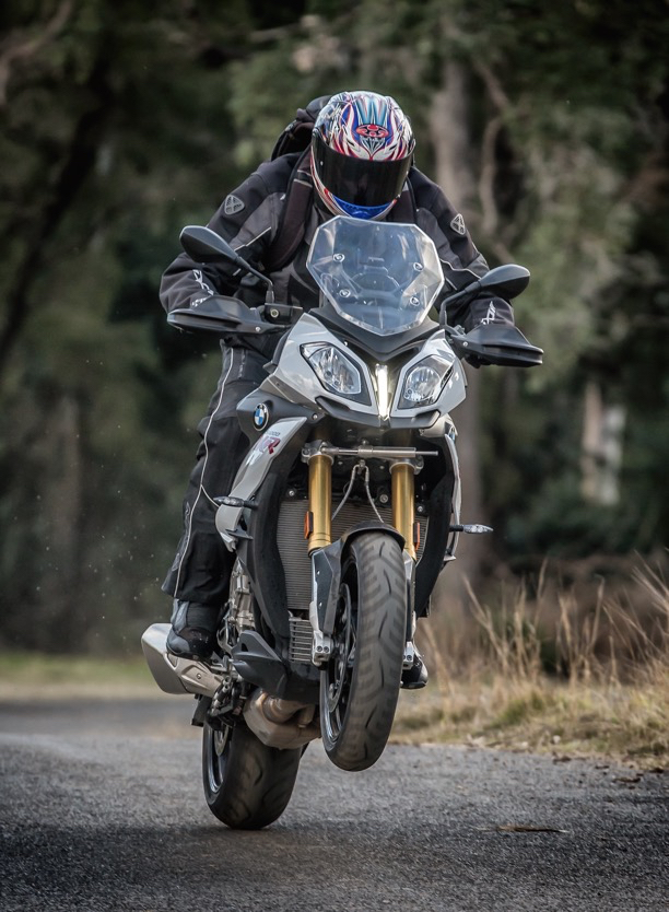 Chris Pickett wheelstanding the BMW S 1000 XR Adventure Sports Touring motorcycle