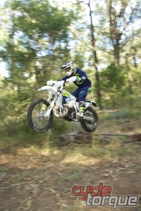 Husqvarna TE250 2016 two stroke enduro wheelie over log
